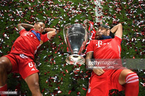 Thiago Alcantara of FC Bayern Munich and Javi Martinez of FC Bayern Munich celebrate with the UEFA Champions League Trophy following their team's...