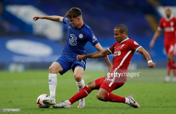Thiago Alcantara of Liverpool tackles Mason Mount of Chelsea during the Premier League match between Chelsea and Liverpool at Stamford Bridge on...