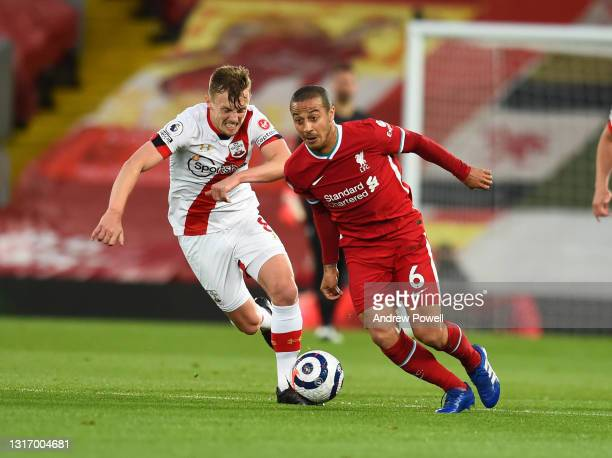 Thiago Alcantara of Liverpool with Southampton's James Ward-Prowse Captain during the Premier League match between Liverpool and Southampton at...