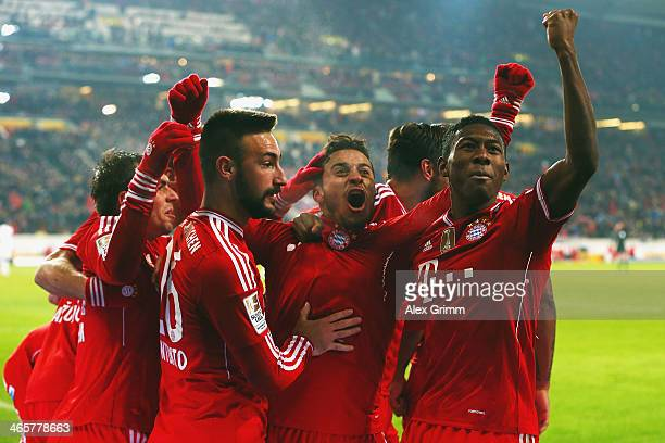 Thiago Alcantara of Muenchen celebrates his team's second goal with team mates during the Bundesliga match between VfB Stuttgart and FC Bayern...