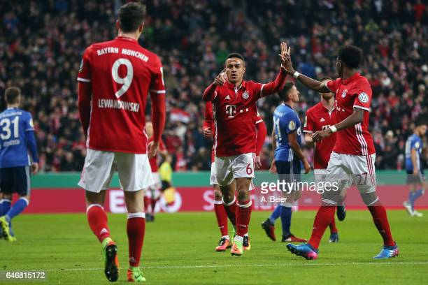 Thiago Alcantara of Muenchen celebrates his team's second goal with team mate Robert Lewandowski during the DFB Cup quarter final between Bayern...