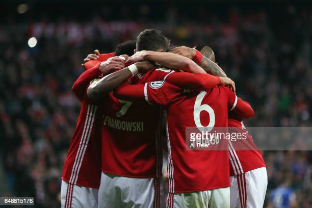 Thiago Alcantara of Muenchen celebrates his team's second goal with team mates during the DFB Cup quarter final between Bayern Muenchen and FC...