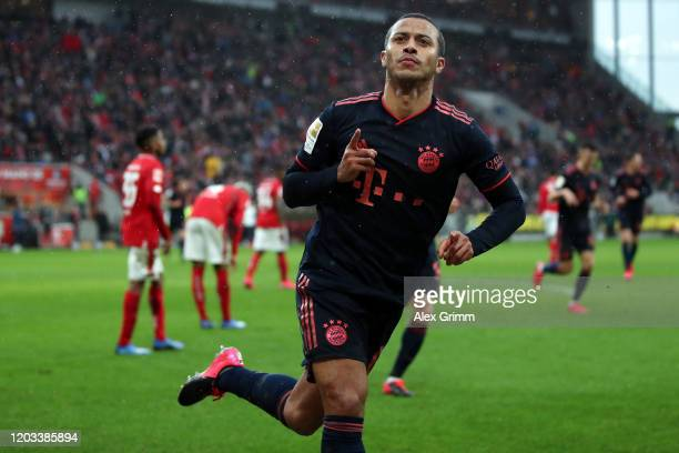 Thiago Alcantara of Muenchen celebrates his team's third goal during the Bundesliga match between 1. FSV Mainz 05 and FC Bayern Muenchen at Opel...