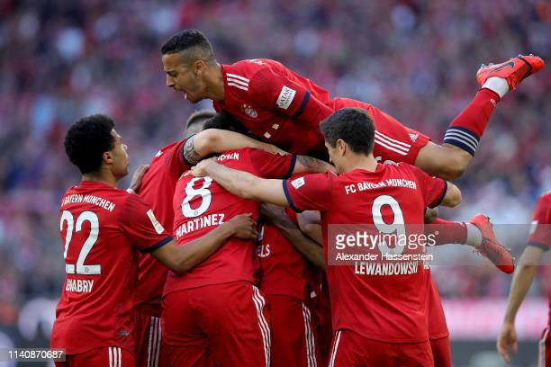 Thiago Alcantara of Muenchen celebrates the opening goal with his team mates during the Bundesliga match between FC Bayern Muenchen and Borussia...