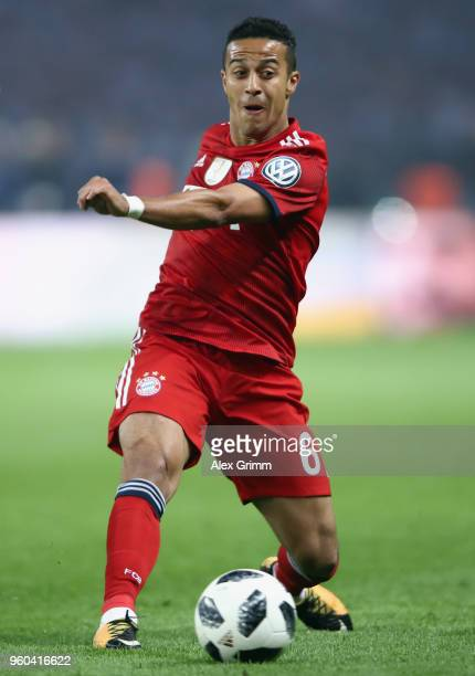 Thiago Alcantara of Muenchen controls the ball during the DFB Cup final between Bayern Muenchen and Eintracht Frankfurt at Olympiastadion on May 19...