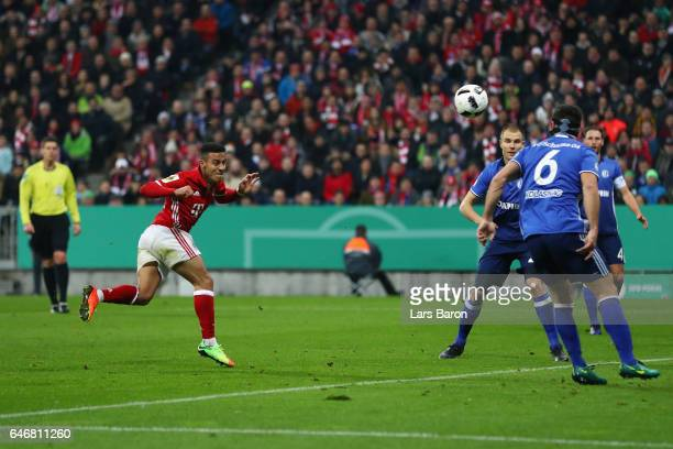 Thiago Alcantara of Muenchen scores his team's second goal during the DFB Cup quarter final between Bayern Muenchen and FC Schalke 04 at Allianz...