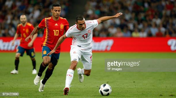 Thiago Alcantara of Spain and Ellyes Skhiri of Tunisia battle for the ball during the friendly match between Spain and Tunisia at Krasnodar's stadium...