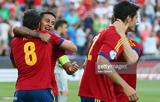 Thiago Alcantara of Spain celebrates his team's first goal with team mates during the UEFA European U21 Championship final match between Italy and...