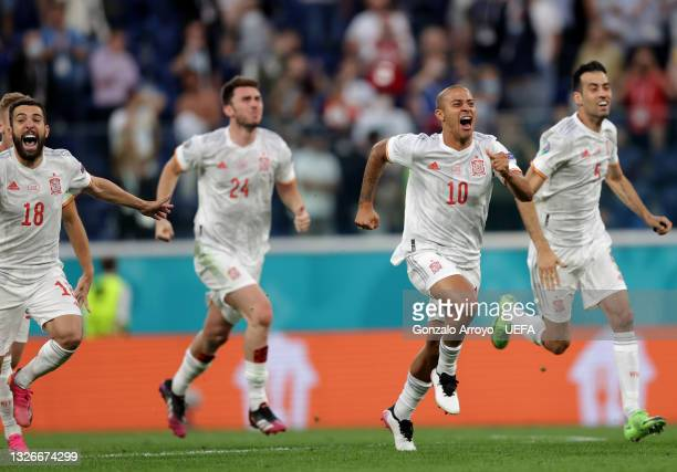 Thiago Alcantara of Spain celebrates with teammates after victory in the penalty shoot out during the UEFA Euro 2020 Championship Quarter-final match...