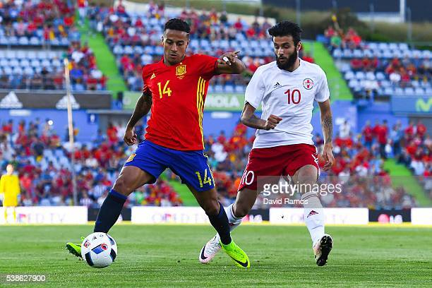 Thiago Alcantara of Spain competes for the ball with Okriashvili of Georgia during an international friendly match between Spain and Georgia at...