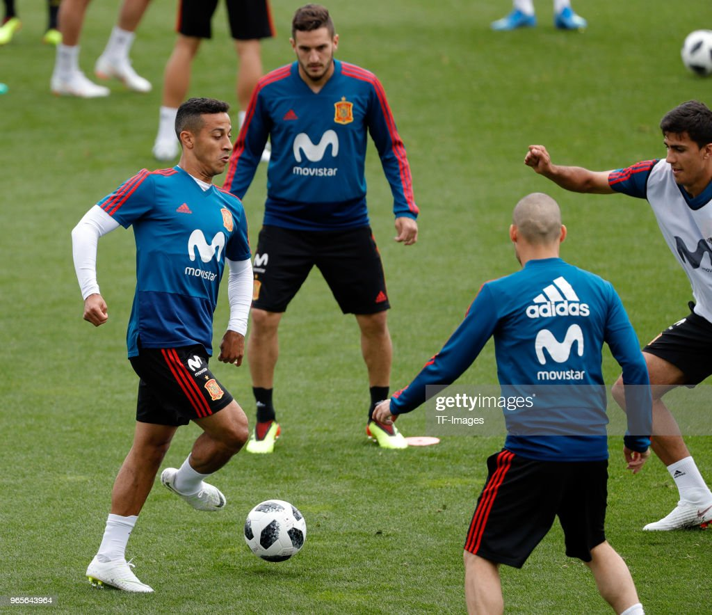 Thiago Alcantara of Spain controls the ball and Koke Resurreccion and Andres Iniesta of Spain look on during a training session on May 30, 2018 in Madrid, Spain.