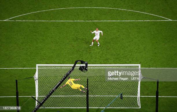Thiago Alcantara of Spain scores their team's third penalty in a penalty shoot out during the UEFA Euro 2020 Championship Semi-final match between...