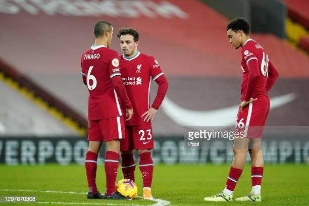 Thiago Alcantara, Xherdan Shaqiri and Trent Alexander-Arnold of Liverpool prepare to take a free kick during the Premier League match between...