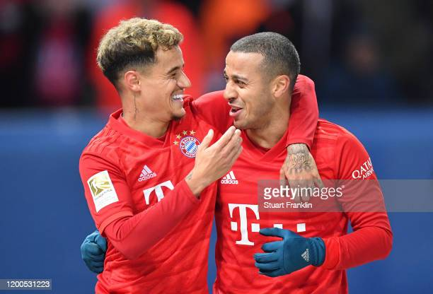 Thiago Alcántara of FC Bayern Muenchen celebrates after scoring his sides third goal with Philippe Coutinho of FC Bayern Muenchen during the...