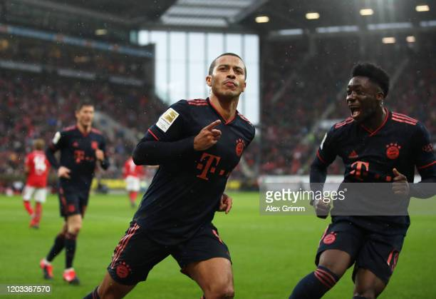 Thiago Alcántara of FC Bayern Muenchen celebrates after scoring his sides third goal during the Bundesliga match between 1 FSV Mainz 05 and FC Bayern...