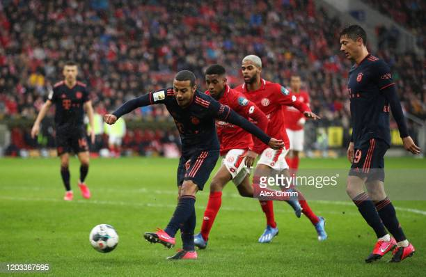 Thiago Alcántara of FC Bayern Muenchen scores his sides third goal during the Bundesliga match between 1 FSV Mainz 05 and FC Bayern Muenchen at Opel...