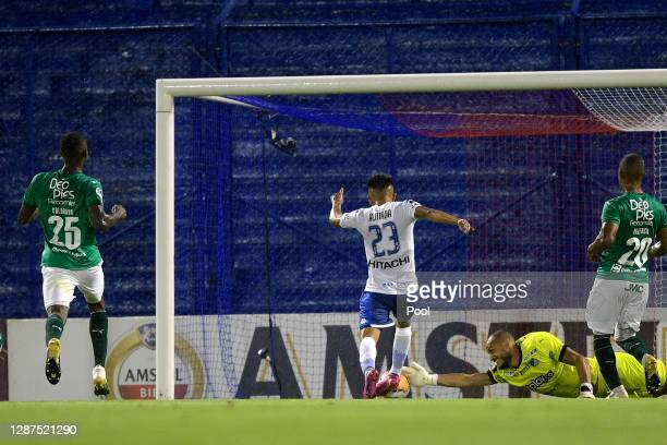 Thiago Almada of Velez kicks the ball to score the first goal of his team during a round of sixteen first leg match between Velez and Deportivo Cali...