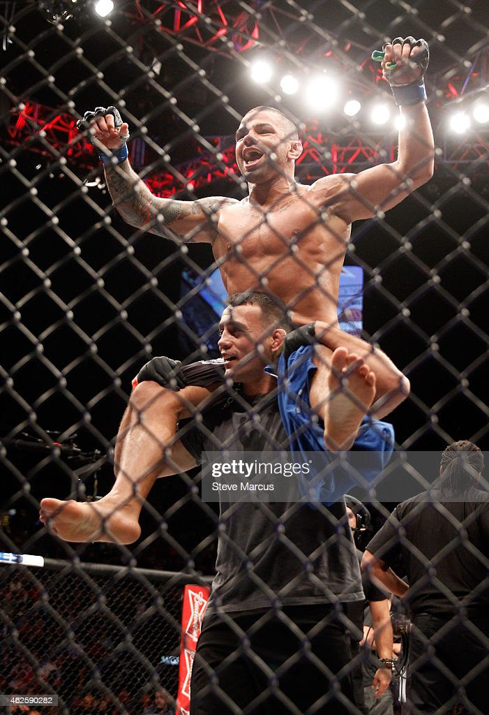 Thiago Alves is lifted up by a member of his team as he celebrates his second-round TKO victory over Jordan Mein in their welterweight bout during UFC 183 at the MGM Grand Garden Arena on January 31, 2015 in Las Vegas, Nevada.