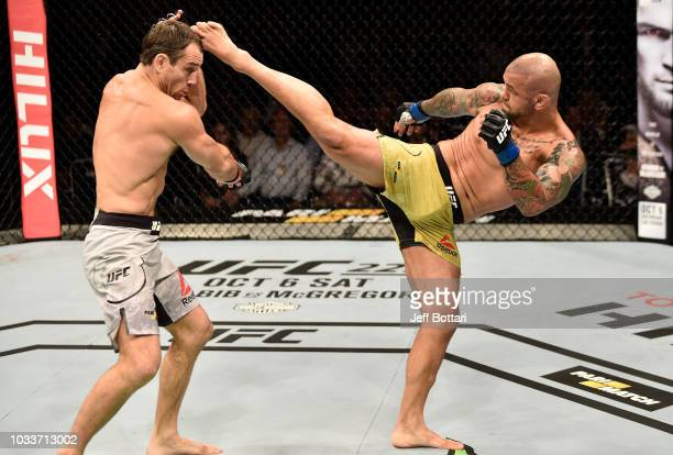 Thiago Alves of Brazil kicks Alexey Kunchenko of Russia in their welterweight bout during the UFC Fight Night event at Olimpiysky Arena on September...
