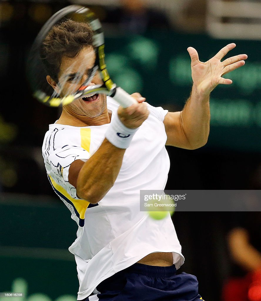 Thiago Alves of Brazil returns a shot against Sam Querrey of the United States during day three of the Davis Cup first round match between the U.S. and Brazil at Veterans Memorial Arena on February 3, 2013 in Jacksonville, Florida.