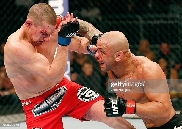 Thiago Alves punches Seth Baczynski in their welterweight bout during the FOX UFC Saturday event at the Amway Center on April 19, 2014 in Orlando,...