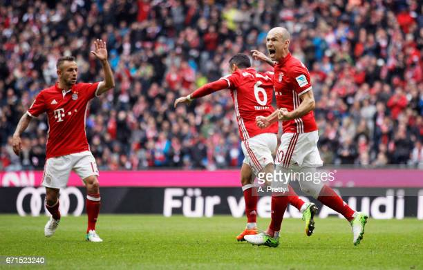 Thiago and Arjen Robben of Bayern Munich celebrate after Thiago scored the second goal during the Bundesliga match between Bayern Muenchen and 1 FSV...