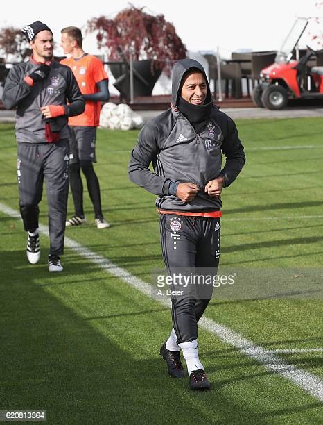Thiago and Mats Hummels of FC Bayern Muenchen arrive for a training session at the club's Saebener Strasse training ground on November 3 2016 in...