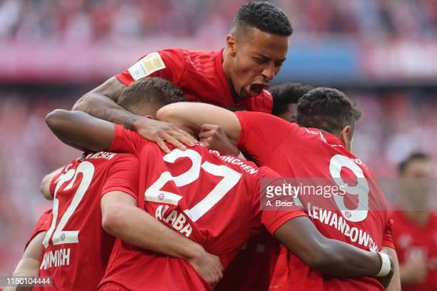 Thiago and teammates of FC Bayern celebrate David Alaba's goal during the Bundesliga match between FC Bayern Muenchen and Eintracht Frankfurt at...