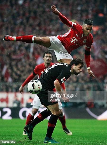 Thiago Bayern Munich heads the ball over Admir Mehmedi of Bayer 04 Leverkusen during the Bundesliga match between Bayern Muenchen and Bayer 04...