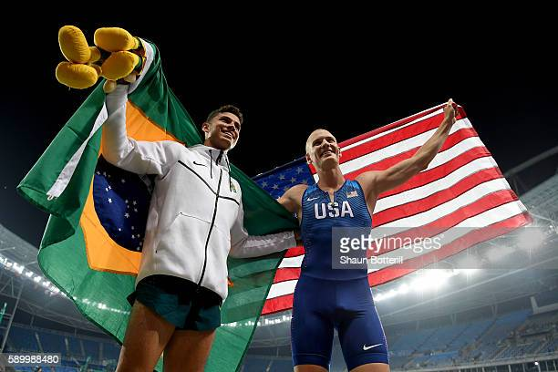 Thiago Braz da Silva of Brazil celebrates winning gold in the Men's Pole Vault final with bronze medalist Sam Kendricks of the United States on Day...