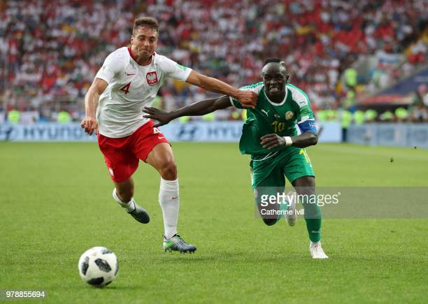Thiago Cionek of Poland battles with Sadio Mane of Senegal during the 2018 FIFA World Cup Russia group H match between Poland and Senegal at Spartak...