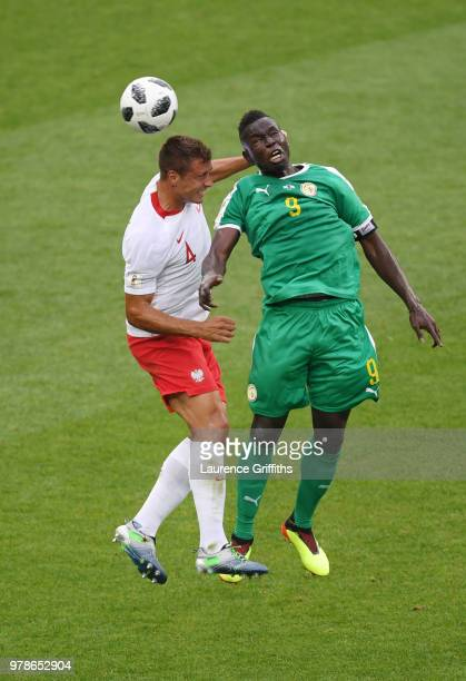 Thiago Cionek of Poland is challenged by Mame Diouf of Senegal during the 2018 FIFA World Cup Russia group H match between Poland and Senegal at...