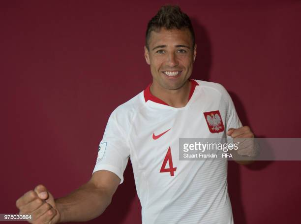 Thiago Cionek of Poland poses for a photograph during the official FIFA World Cup 2018 portrait session at on June 14 2018 in Sochi Russia