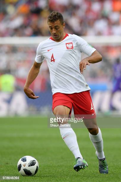 Thiago Cionek of Poland runs with the ball during the 2018 FIFA World Cup Russia group H match between Poland and Senegal at Spartak Stadium on June...