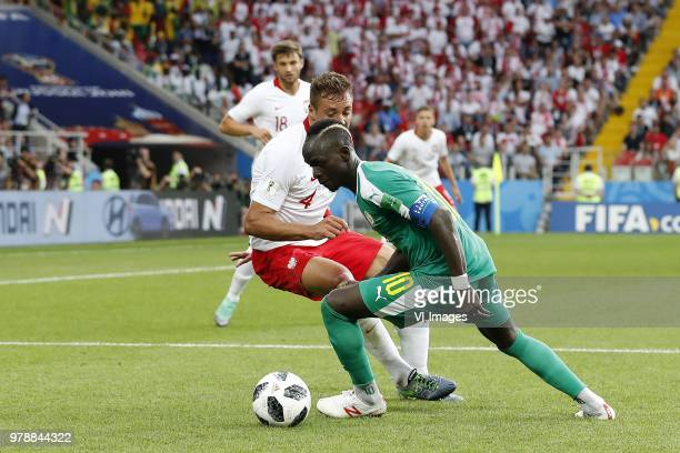 Thiago Cionek of Poland Sadio Mane of Senegal during the 2018 FIFA World Cup Russia group H match between Poland and Senegal at the Otkrytiye Arena...