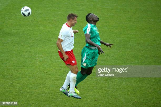 Thiago Cionek of Poland Salif Sane of Senegal during 2018 FIFA World Cup Russia group H match between Poland and Senegal at Spartak Stadium on June...