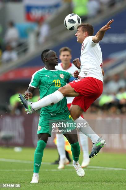 Thiago Cionek of Poland wins a header from Sadio Mane of Senegal during the 2018 FIFA World Cup Russia group H match between Poland and Senegal at...