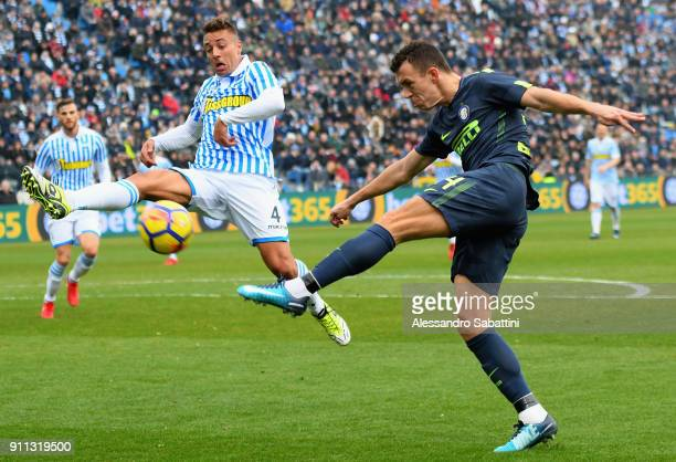 Thiago Cionek of Spal competes for the ball with Ivan Perisic of FC Internazionale during the serie A match between Spal and FC Internazionale at...
