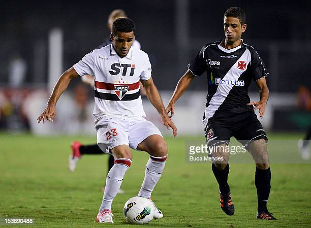 Thiago Feltri of Vasco struggles for the ball with Douglas of Sao Paulo during a match between Vasco and Sao Paulo as part of the brazilian...