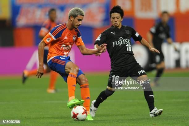 Thiago Galhardo of Albirex Niigata and Tatsuya Hasegawa of Kawasaki Frontale compete for the ball during the J.League J1 match between Albirex...