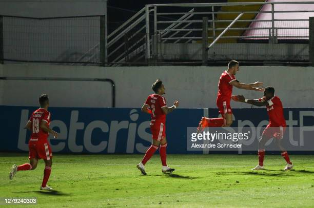 Thiago Galhardo of Internacional celebrates with his team mates after scoring the second goal of their team during the match against Red Bull...
