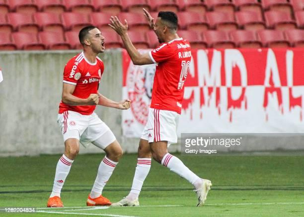 Thiago Galhardo of Internacional celebrates with teammate Rodrigo Lindoso after scoring the second goal of their team during the match against...