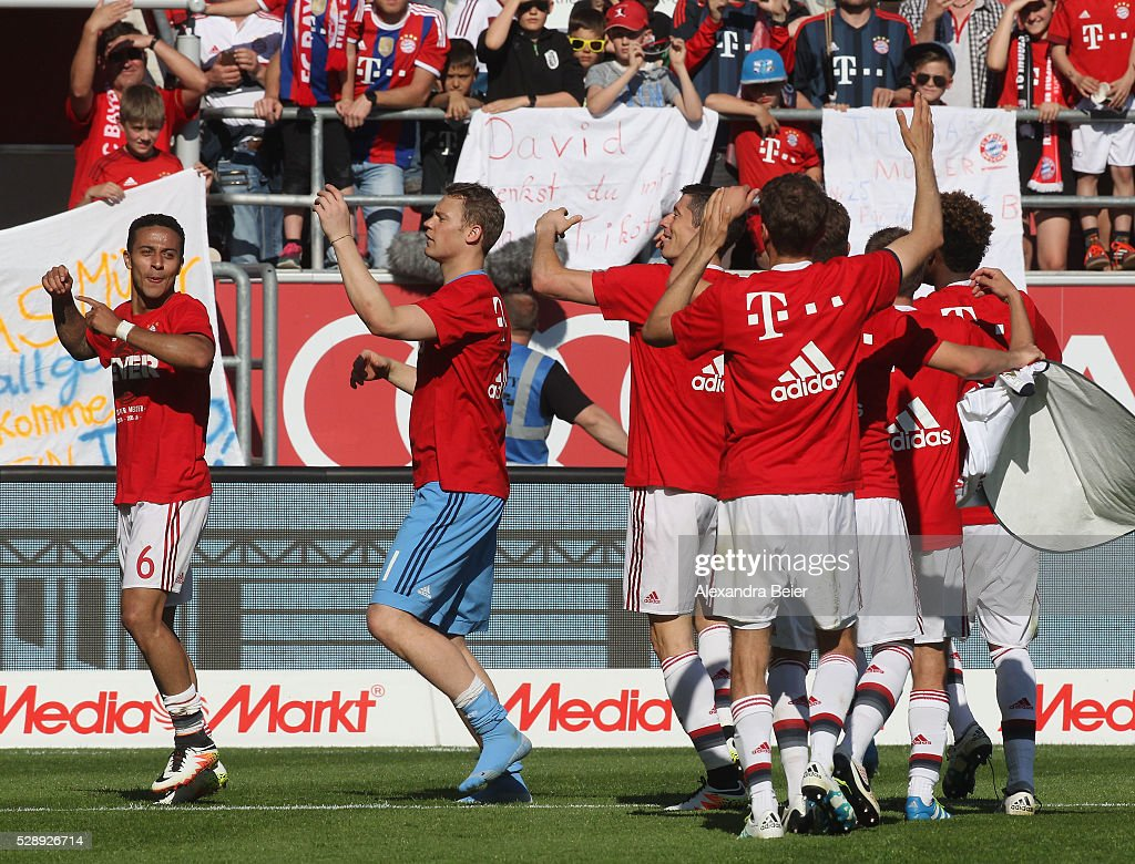 Thiago, goalkeeeper Manuel Neuer, Robert Lewandowski and teammates (L-R) of Bayern Muenchen celebrate their German Championship title after the Bundesliga match between FC Bayern Muenchen and FC Ingolstadt at Audi Sportpark on May 7, 2016 in Ingolstadt, Germany.