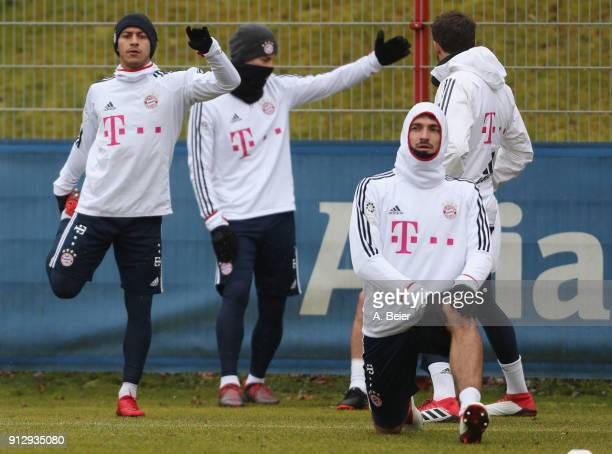 Thiago James Rodriguez Mats Hummels and Javi Martinez of FC Bayern Muenchen warm up during a training session at the club's Saebener Strasse training...