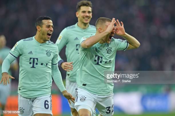 Thiago Leon Goretzka and Joshua Kimmich of Muenchen celebrate their teams first goal during the Bundesliga match between Hannover 96 and FC Bayern...