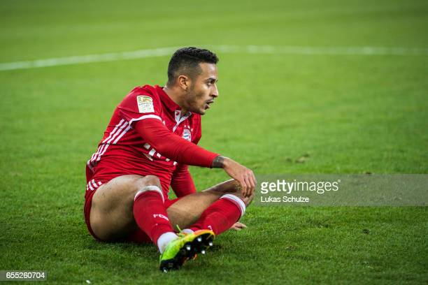 Thiago lies on the pitch during the Bundesliga match between Borussia Moenchengladbach and Bayern Muenchen at BorussiaPark on March 19 2017 in...