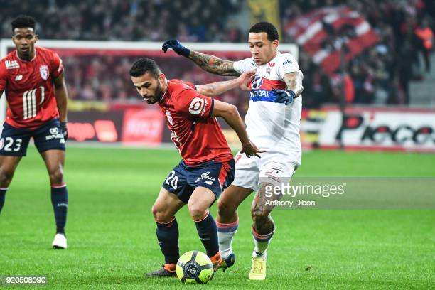 Thiago Maia of Lille and Memphis Depay of Lyon during the Ligue 1 match between Lille OSC and Olympique Lyonnais at Stade Pierre Mauroy on February...