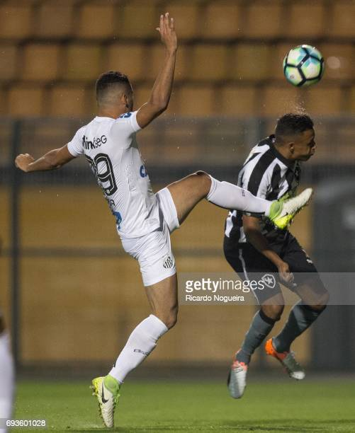 Thiago Maia of Santos battles for the ball with Matheus Fernandes 11# of Botafogo during the match between Santos and Botafogo as a part of...