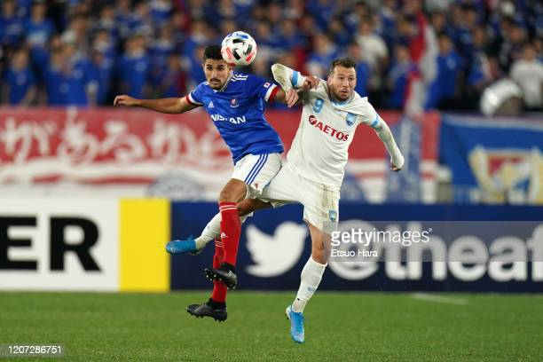 Thiago Martins of Yokohama FMarinos and Adam Fondre of Sydney FC compete for the ball during the AFC Champions League Group H match between Yokohama...