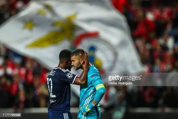 Thiago Mendes of Olympique Lyonnais conforts Anthony Lopes of Olympique Lyonnais at the end of the UEFA Champions League group G match between SL...